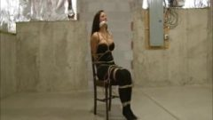 Busty Lady Struggles Bound And Gagged