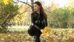 Sensuous Ginger In Latex Catsuit And Balletboots Walking In Public