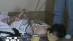 Chinese Female Struggling Under Tight Rope Bondage