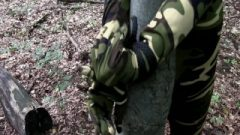 Soldier Female Roped To Tree Camouflage Catsuit And Leather Boots